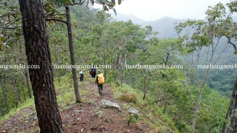 trekking a long narrow hilltop